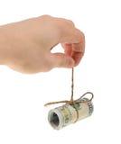 A mão do homem guarda um rolo das cédulas dos dólares isolados no fundo branco fotografia de stock