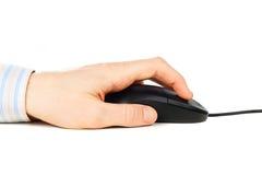 Mão do homem no rato do computador imagem de stock royalty free