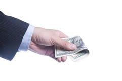 A mão do homem prende um bloco dos dólares Fotos de Stock