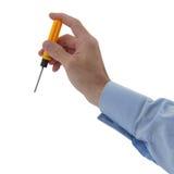 A mão do homem que guarda a chave de fenda fotos de stock royalty free