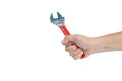 Mão do homem que guarda o isolado manual da chave no fundo branco, grampo Fotografia de Stock