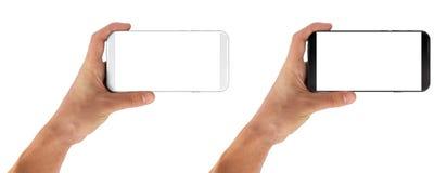 Mão do homem que mantém molduras do smartphone menos horizontais Imagem de Stock Royalty Free