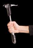 Mão do homem que prende uma bomba Fotografia de Stock