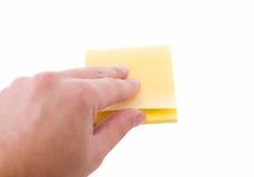Mão do homem que rasga uma etiqueta. Foto de Stock Royalty Free