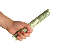 Mão do menino com primeiro dólar imagens de stock royalty free