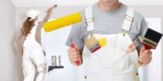 Mão do pintor com escova de pintura Imagem de Stock Royalty Free
