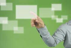 Mão do ponto do homem de negócios a uma caixa branca vazia do retângulo fotografia de stock royalty free