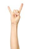 Mão do ` s da mulher que mostra o gesto da rocha fotos de stock