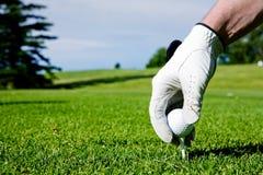 Mão do T de golfe fotografia de stock