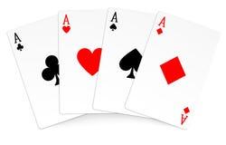 Mão do vencedor do póquer de quatro cartões de jogo dos ás Fotografia de Stock