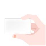 Mão do vetor que prende o cartão em branco Imagem de Stock