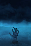 Mão do vivo no azul Imagem de Stock