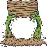 Mão do zombi dos desenhos animados que guarda a placa de madeira ilustração royalty free