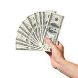 A mão dos homens prende um ventilador dos dólares Fotografia de Stock
