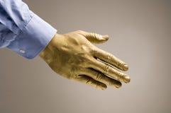 Mão dourada Fotos de Stock