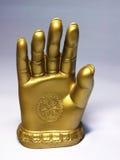 Mão dourada Fotografia de Stock