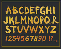 Mão dourada fonte tirada Alfabeto e números modernos escritos mão do brilho Símbolos do projeto do vetor Fotografia de Stock