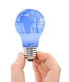 Mão e bulbo com globo Imagem de Stock Royalty Free