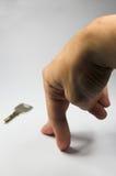 Mão e chave Foto de Stock