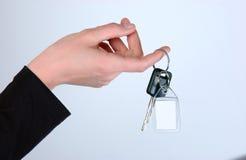 Mão e chave Foto de Stock Royalty Free