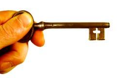Mão e chave velha Fotos de Stock