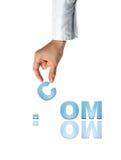 Mão e .COM Fotografia de Stock Royalty Free