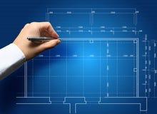 Mão e conceito do modelo com o coordenador que trabalha na cópia azul Imagem de Stock Royalty Free