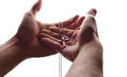 Mão e cruz fotografia de stock royalty free