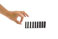 Mão e dominós Fotografia de Stock