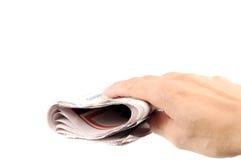 Mão e jornal fotos de stock