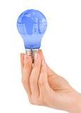 Mão e lâmpada com globo Imagens de Stock Royalty Free