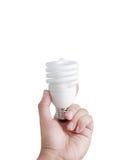 Mão e lâmpada fluorescente isoladas Imagens de Stock Royalty Free