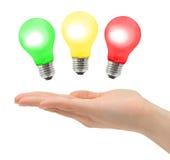 Mão e lâmpadas Imagem de Stock