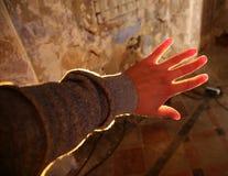 A mão e a luz Fotos de Stock Royalty Free