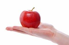 Mão e maçã Imagens de Stock