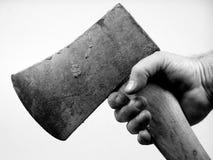 Mão e machado. Foto de Stock