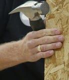 Mão e martelo Imagens de Stock