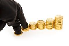 Mão e moedas Foto de Stock