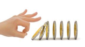 Mão e moedas de queda Foto de Stock Royalty Free