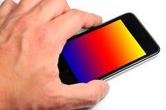 Mão e telefone móvel Imagem de Stock