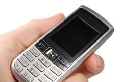 Mão e telefone móvel isolados imagens de stock