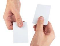 Mão e um cartão Imagem de Stock