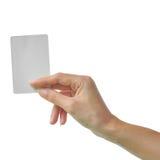 Mão e um cartão isolado Imagens de Stock