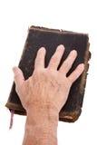Mão em uma Bíblia imagens de stock