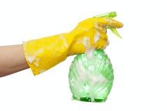 Mão em uma luva de borracha amarela Fotos de Stock Royalty Free