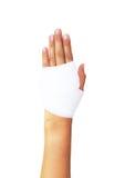 Mão enfaixada no branco, com trajeto de grampeamento Foto de Stock Royalty Free
