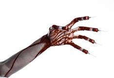 Mão ensanguentado com a seringa nos dedos, seringas dos dedos do pé, seringas da mão, mão ensanguentado horrívea, tema do Dia das Foto de Stock Royalty Free