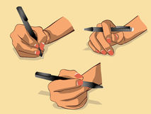 A mão escreve algo pela versão preta 2 da pena Fotos de Stock