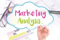 A mão escreve a análise de mercado Fotografia de Stock Royalty Free