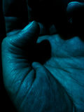 Mão escura Fotos de Stock Royalty Free